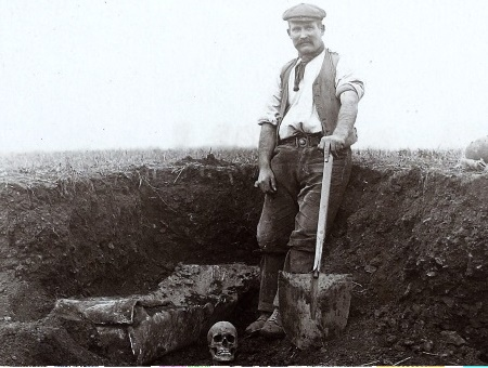 Man digging a grave